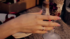 Female hand takes a glass of wine at sunset in the park Stock Footage
