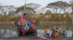Kids playing in harbour,Ceribon,Java,Indonesia Stock Footage