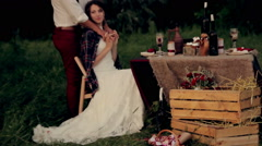 Beautiful young couple bride groom warms the cool evening for a  romantic Stock Footage