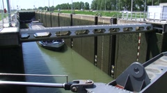 LOCK COMPLEX MAASBRACHT Inland ship in lock chamber, water being lowered Stock Footage