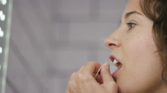 4K Shot of woman using dental floss, in slow motion, shot on Red Epic Dragon - stock footage
