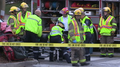 Police ambulance and firefighters at car accident and crash scene in Waterloo Arkistovideo