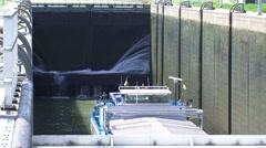 LOCK COMPLEX MAASBRACHT  Water leaking through the steel door of a lock chamber Stock Footage