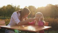 Family values: Mother and child eating ice cream at sunset Stock Footage