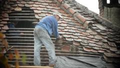 Workers covering a roof with tile 02 Stock Footage