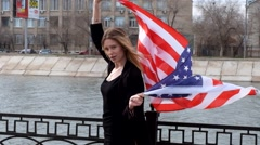 Blond haired woman with american flag Stock Footage