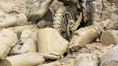 Enduro bike stuck in obstacle mud on race track. Stock Footage