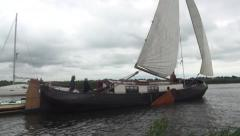 Classic sailyacht sailing in the canals of Friesland. - stock footage