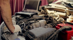 Service and repair, computer  diagnostics: a mechanic check the car for faults Stock Footage