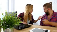 Young couple just move to their new apartment. They are arguing - stock footage