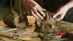 Young female art student scultping pottery clay Stock Footage
