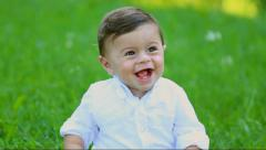 Close up portrait of beautiful baby boy with whide cute smile Stock Footage