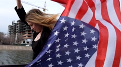 Young woman posing with american flag - stock footage
