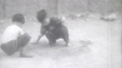 Vintage Film Black White- 1956 Hong Kong  Young Boys Play Dirt Street Outdoors - stock footage
