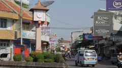 Small clocktower and Kota road with light traffic,Ceribon,Java,Indonesia Stock Footage