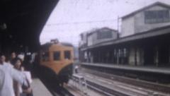 Old Vintage Film 1956  Japan People Waiting Train Station Train Pulls In Outdoor Stock Footage