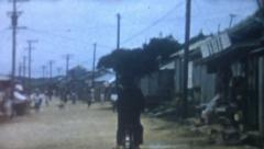 Vintage Film 1956  Japan - Okinawa Street Scene Men Ride Bicycle Dirt Road Rural Stock Footage