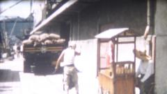 Old Vintage Film 1956 Japan - Cargo Truck on Dock Man Large Knife Street Vendor Stock Footage