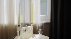 Romantic set with champagne glasses and candles Stock Footage