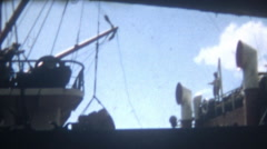 Vintage Film 1950's Japan Workers Loading Cargo on a Ship Crane Lifting Outdoors Stock Footage