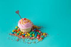 One cupcake on aquamarine background Stock Photos