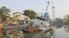 Half sinking boat in port,Ceribon,Java,Indonesia Stock Footage