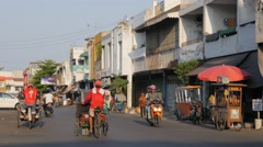 Bicycle rickshaws on road,Ceribon,Java,Indonesia Stock Footage