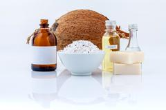 Coconut essential Oils natural Spa Ingredients for scrub ,massage and skin ca Stock Photos