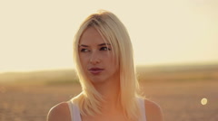 Beautiful face of young sexy girls closeup on sunset sunshine straightens  long Stock Footage