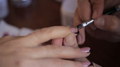 Stock Video Footage of brush application of gel nails while correction color black