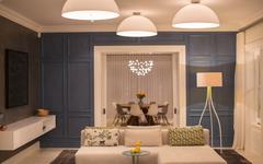Illuminated domed lights over home showcase living room - stock photo