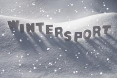 White Word Wintersport On Snow, Snowflakes Stock Photos