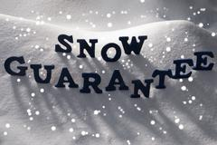 Blue Word Snow Guarantee, Snowflakes Stock Photos