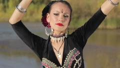 Girl dancing exotic belly dance on nature - stock footage