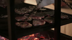 Juicy steaks sizzle on flaming and smoking grill Stock Footage