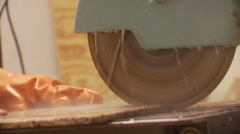 Slab of granite being cut with circular saw Stock Footage