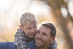 Affectionate father and son piggybacking - stock photo