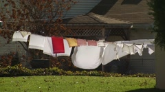 Clothes drying on clothesline - stock footage