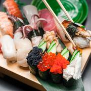 Premium quality sushi rolls served in Japanese restaurant. Asian food Stock Photos