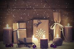 Vintage And Shabby Chic Purple Christmas Gift With Candle, Stars - stock photo