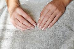 Woman hands with beautiful french manicure Stock Photos