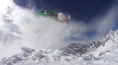 Snowboarder doing a back flip on mountain Stock Footage