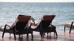 Woman relaxing on sun lounger Stock Footage