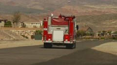 Fire brigade leaving from fire station Stock Footage