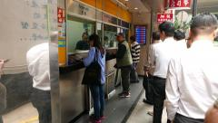 People queue currency exchange office cashier, outdoor money change Stock Footage