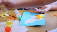children cut out of paper and glue models of space rockets - stock footage