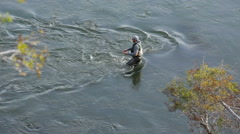 Man fly fishing in river - stock footage