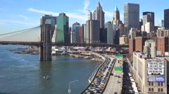 The Brooklyn Bridge, East River and FDR parkway on a clear sunny day in New York - stock footage
