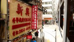 Chinese signboards slide beside, as seen from moving vehicle, second floor - stock footage