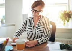 Stock Photo of Successful female entrepreneur working at home